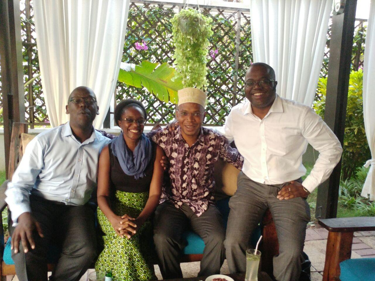 Aidan Eyakuze, Neema Ndunguru, January Makamba, and Charles Washoma meeting in Dar es Salaam